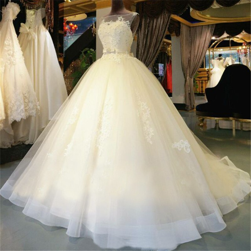 Elegant Lace Appliques Bateau Neck Sleeveless Floor Length Tulle Wedding Gown Featuring Bow Accent Belt High Quality Bridal Dresses